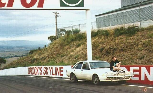 Andy on Mt Panorama, site of the race! etc. Also note car that doesn't exist anymore.