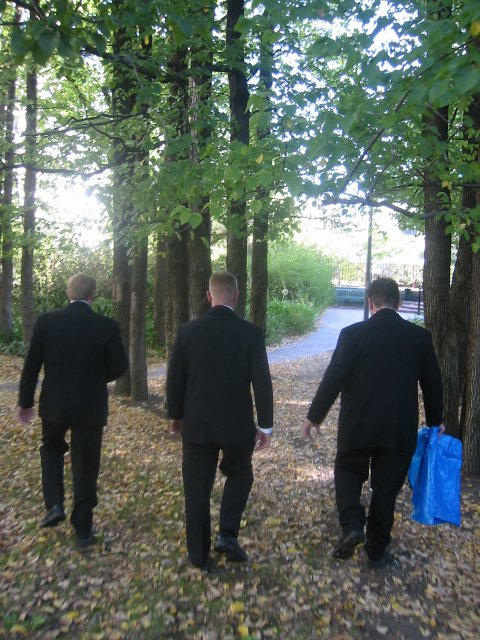 Groom, Brother in Law and Friend walk away