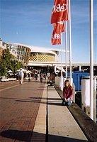 Day 03 - 12 - Darling Harbour Boardwalk - Ali kneeling